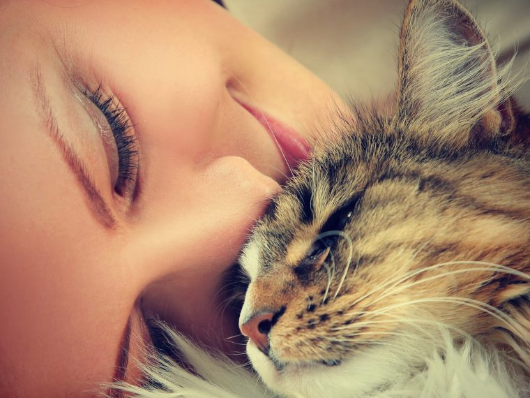 cute young woman with cat